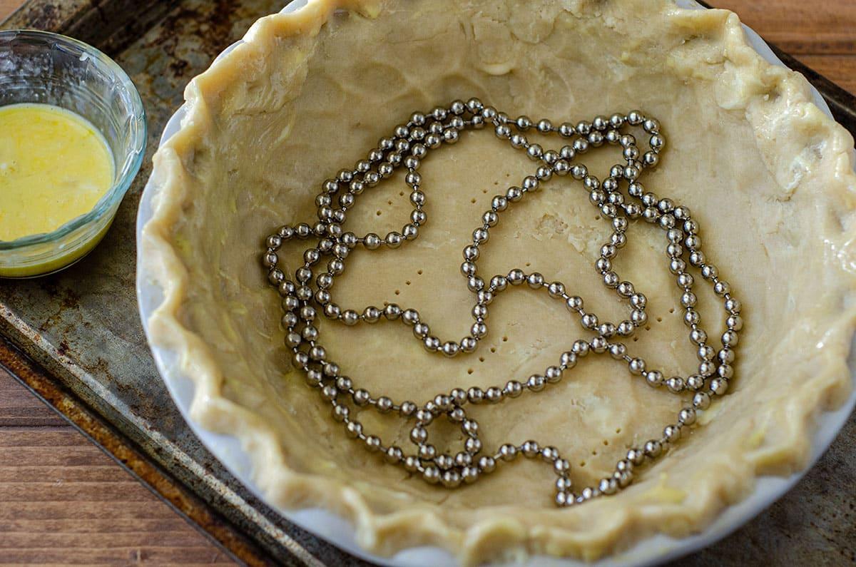 pie chain in a pie crust before blind baking
