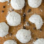 Chocolate Chip Snowballs: Buttery, melt-in-your-mouth shortbread cookies filled with mini-chocolate chips and rolled in powdered sugar.