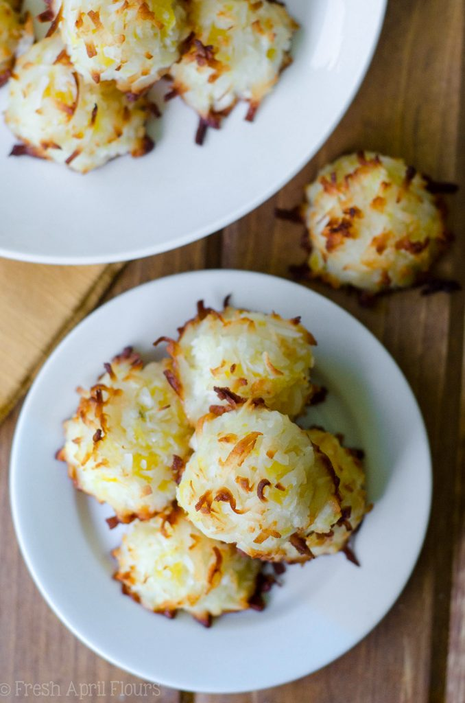 Piña Colada Macaroons: Easy coconut macaroons filled with crushed pineapple and spiked with a touch of coconut rum.
