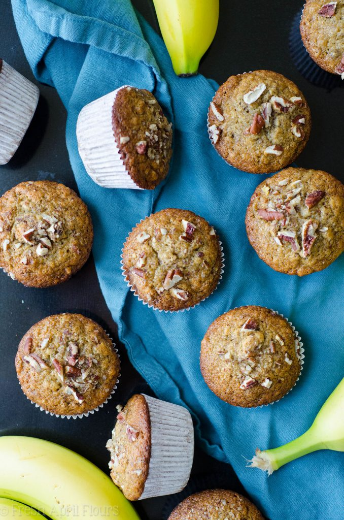 Banana Nut Muffins: Crunchy brown sugared muffin tops lead the way to moist and tender banana centers, studded with plenty of toasty pecans!