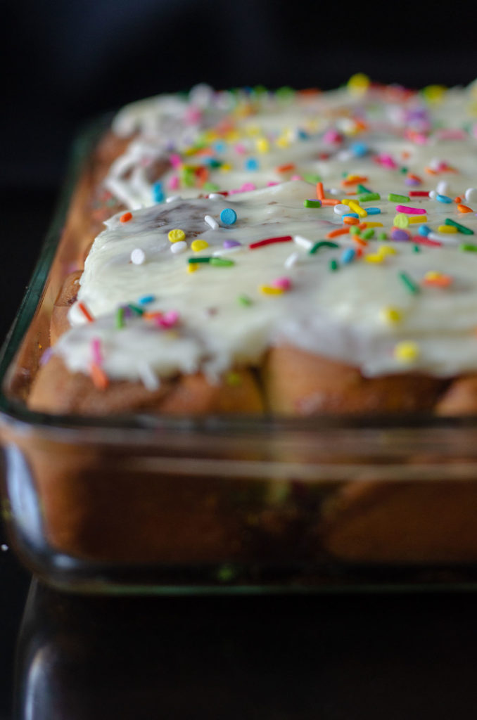Funfetti Cinnamon Rolls: Simple yeast rolls filled with sweet and gooey cinnamon and studded with sprinkles. Spread with easy cream cheese frosting for an indulgent breakfast or treat!