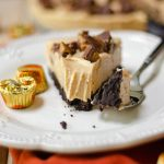 No Bake Peanut Butter Pie: A light and creamy peanut butter filling atop a crushed Oreo crust. The chopped peanut butter cups on top seal the deal for a perfect no bake pie!