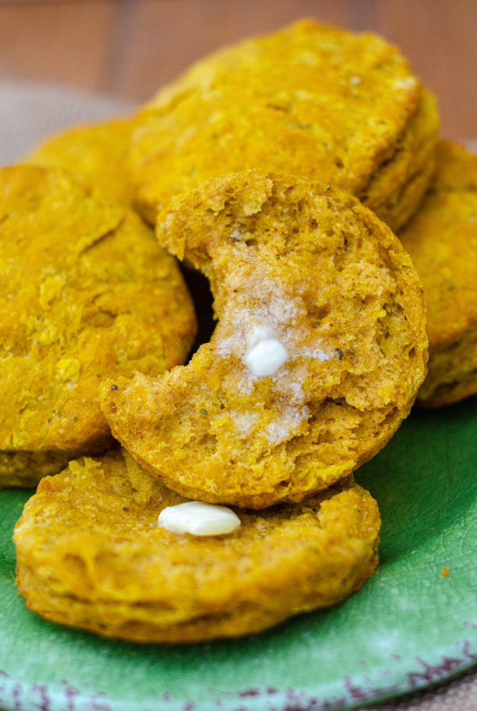 Savory Herbed Pumpkin Biscuits: Flaky, buttery biscuits made with real pumpkin and spiced with sage, thyme, and ginger.