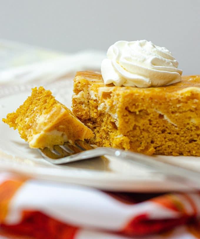 Pumpkin Cheesecake Swirl Sheet Cake: Dense and flavorful pumpkin cake swirled with sweet and creamy cheesecake.
