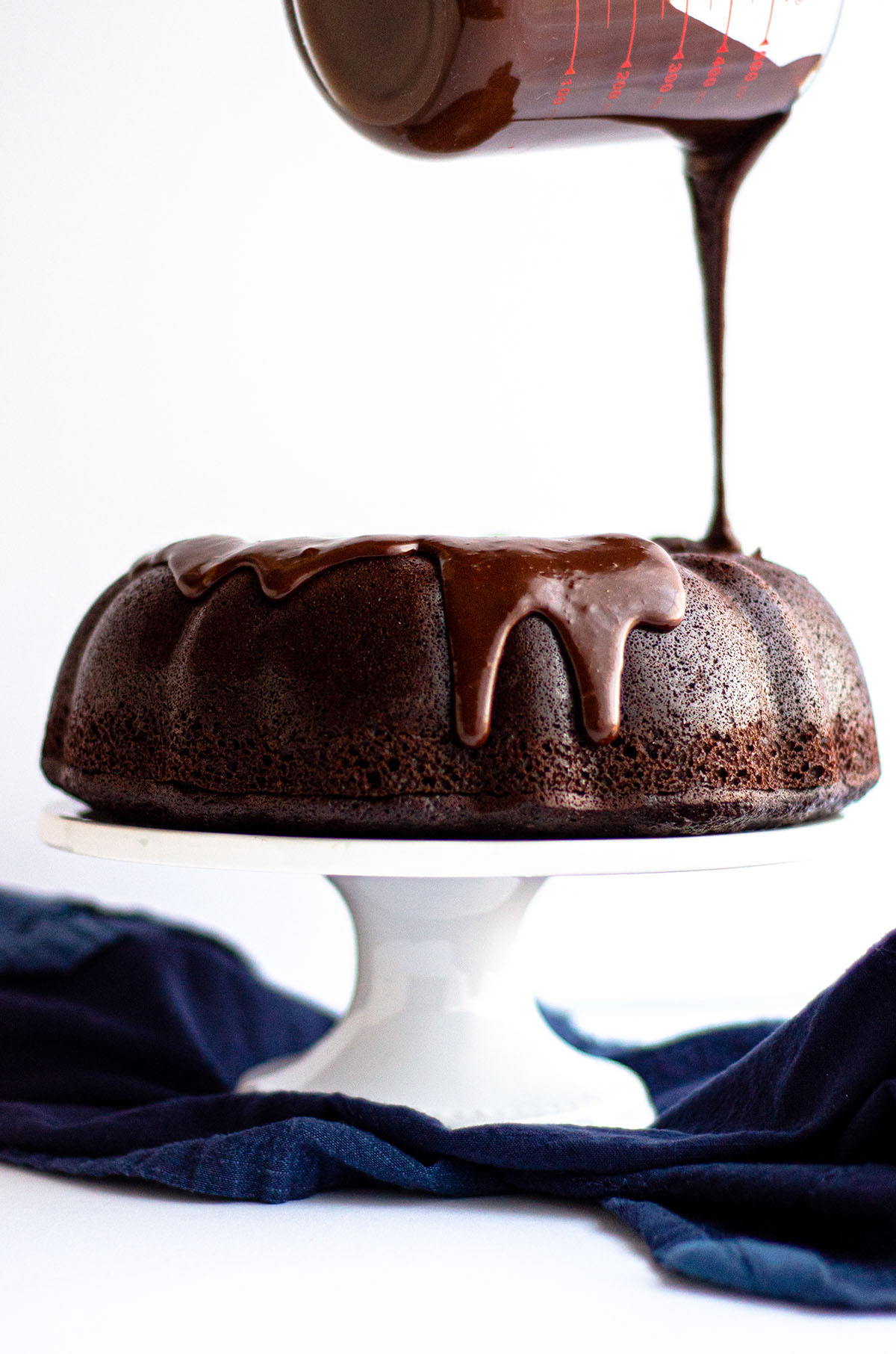 A simple chocolate cake made with rich, deep flavors and topped with a smooth chocolate ganache.