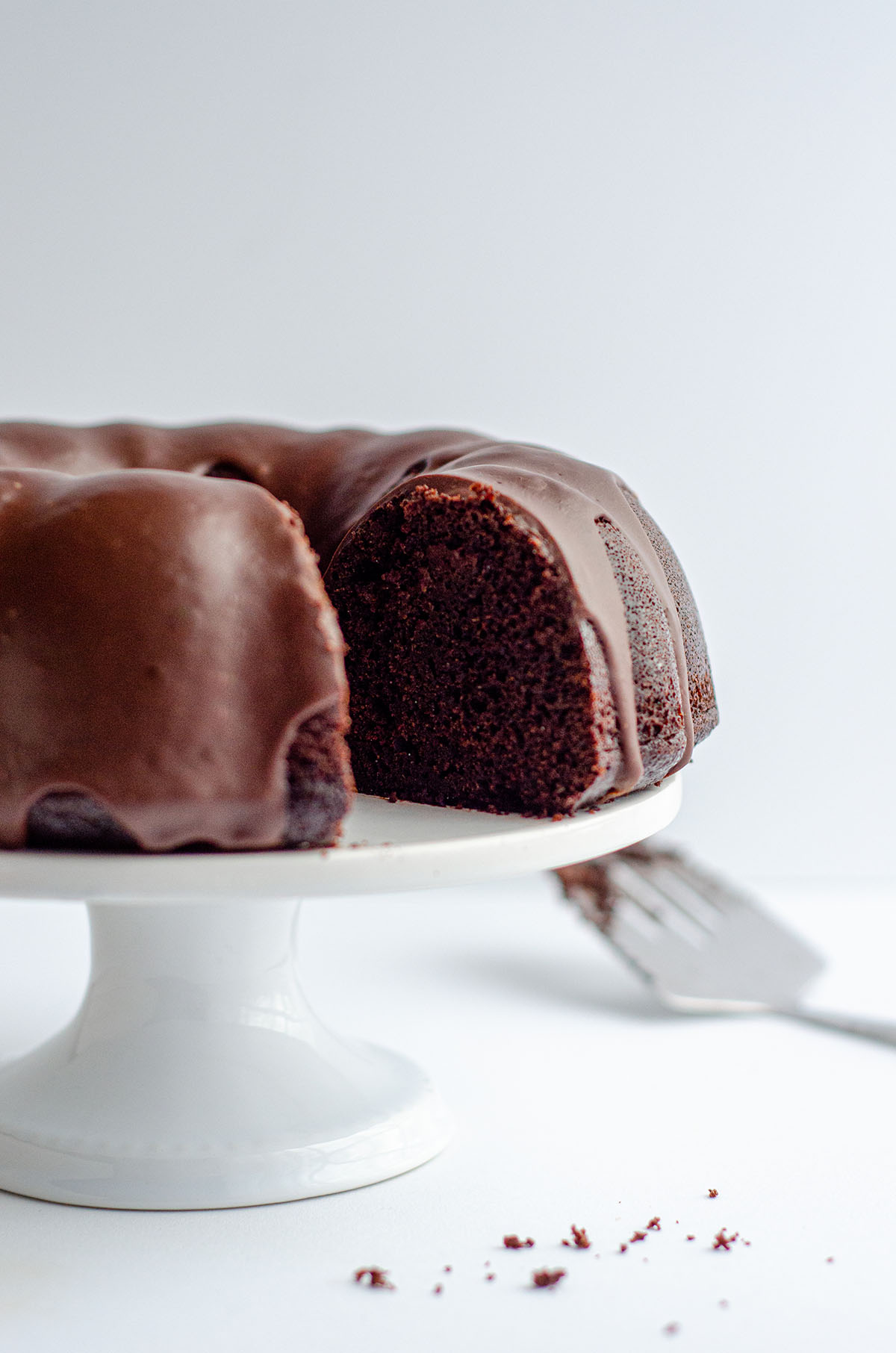 chocolate bundt cake on a cake stand