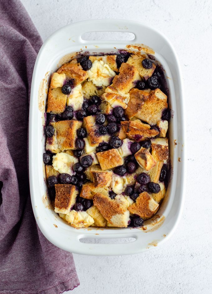 aerial photo of baked blueberry french toast in a casserole dish