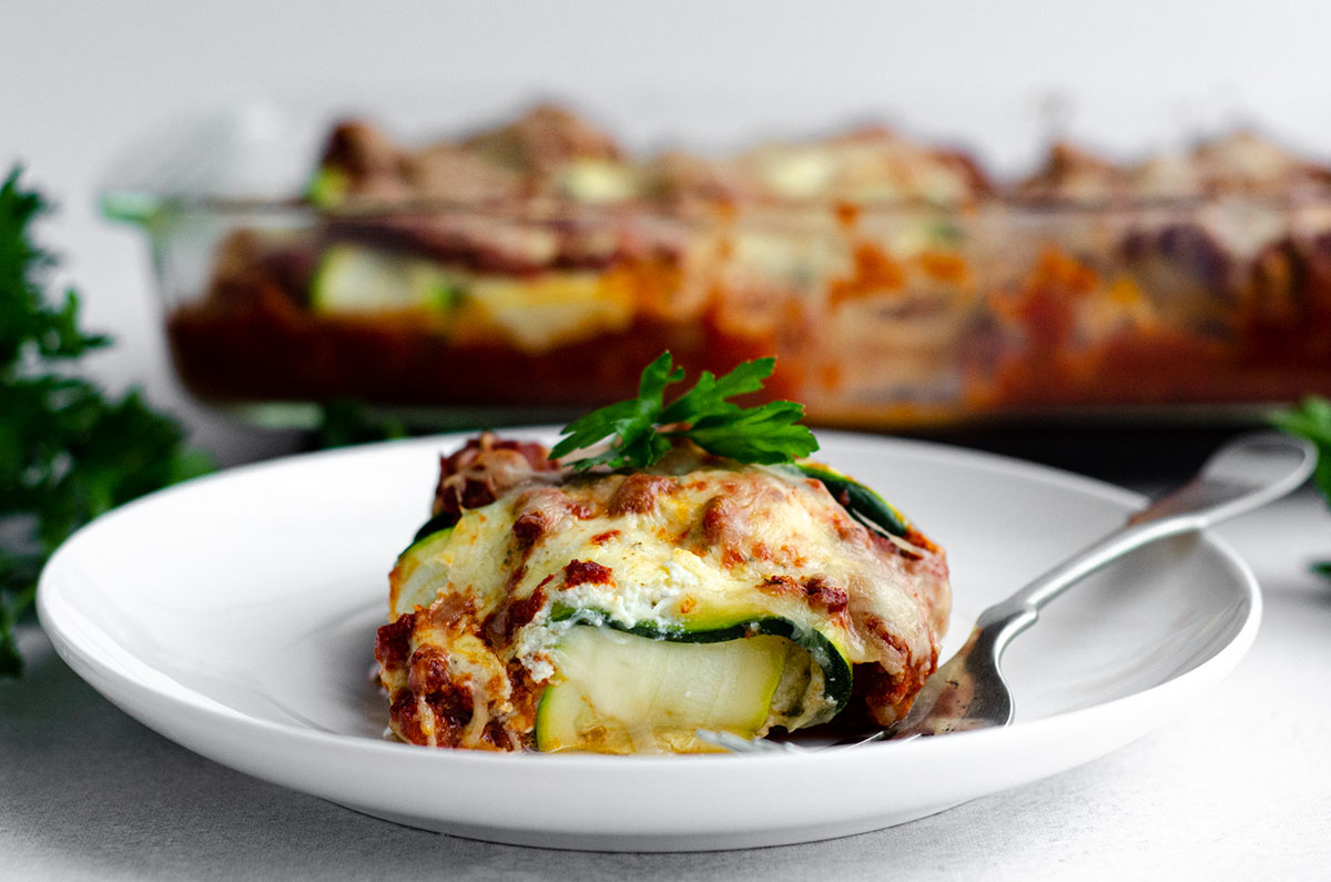 zucchini ravioli on a plate with a fork