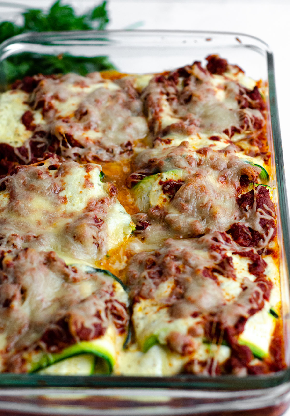 baked zucchini ravioli in a baking dish ready to serve