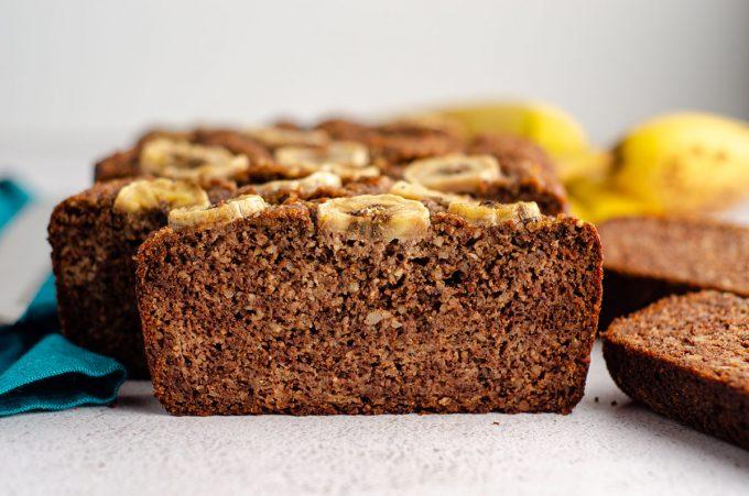 sliced almond flour banana bread sitting on a platter
