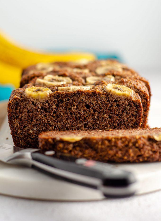 sliced almond flour banana bread on a serving platter