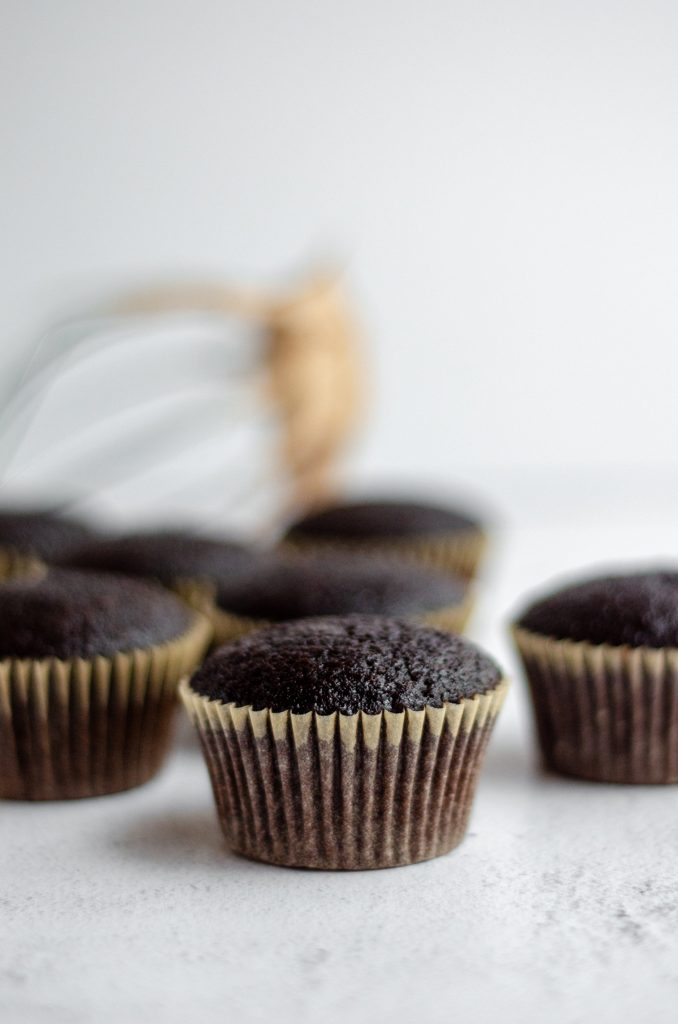 chocolate cupcakes ready to be piped with frosting