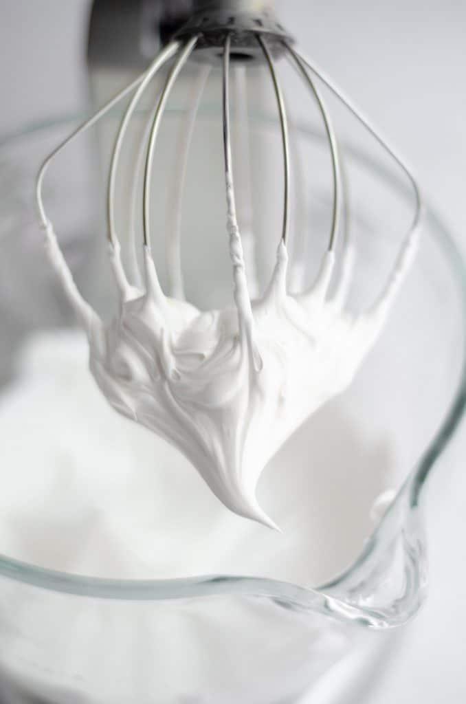 whipped egg whites ready to make swiss meringue buttercream
