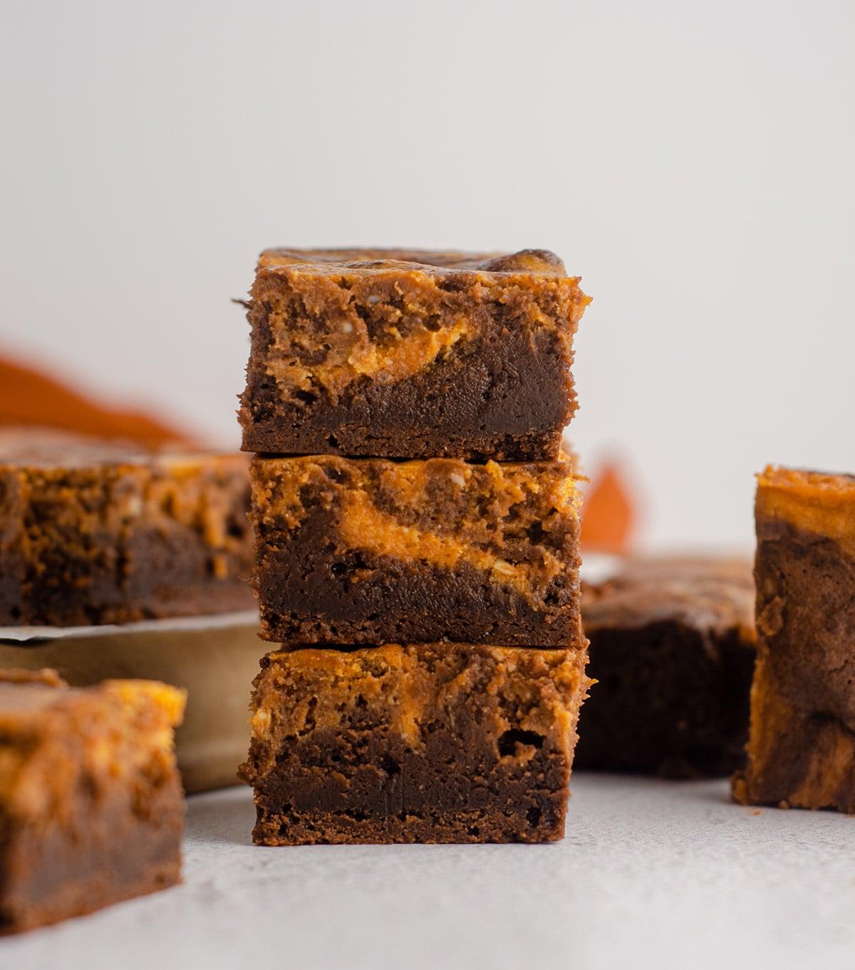 stack of pumpkin cheesecake brownies
