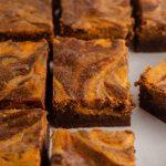 sliced pumpkin cheesecake brownies