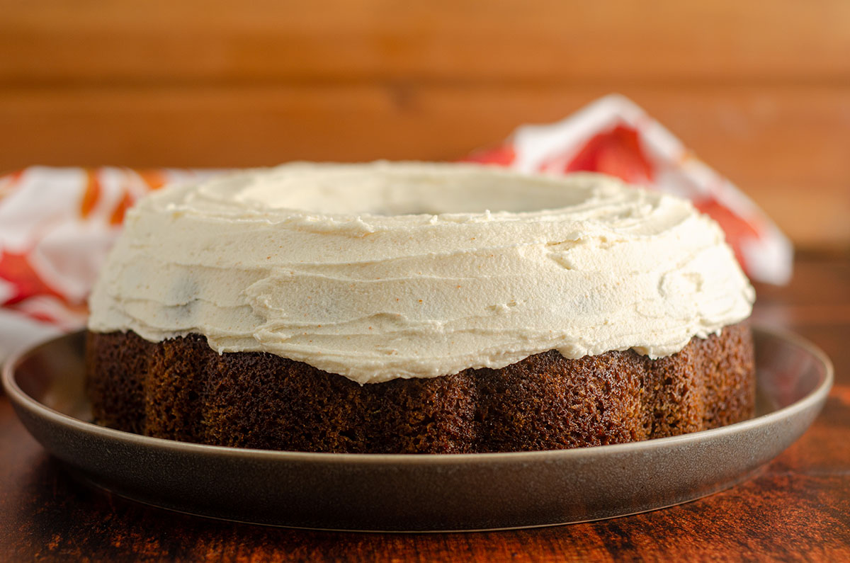 pumpkin bundt cake with browned butter buttercream sitting on a plate