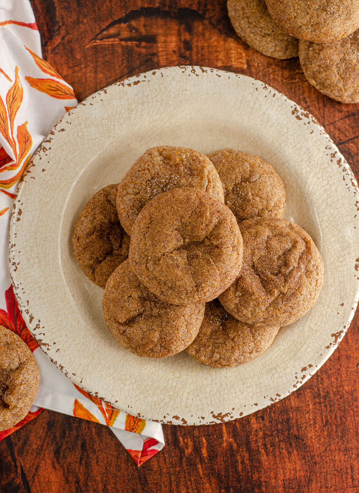 aerial photo of pumpkin spice cookies sitting on a cream colored plate