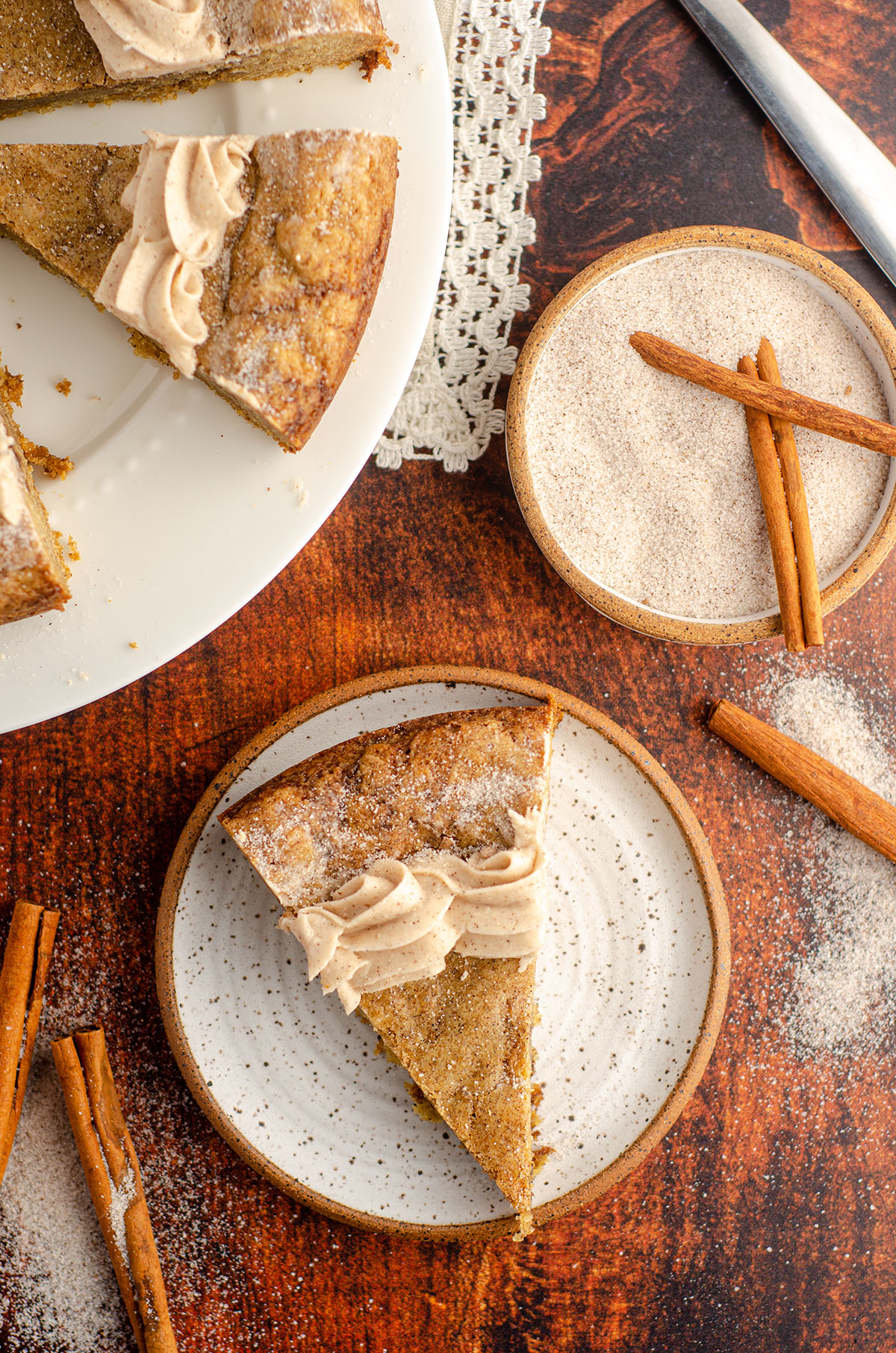 aerial photo of snickerdoodle cookie cake sitting on a ceramic plate