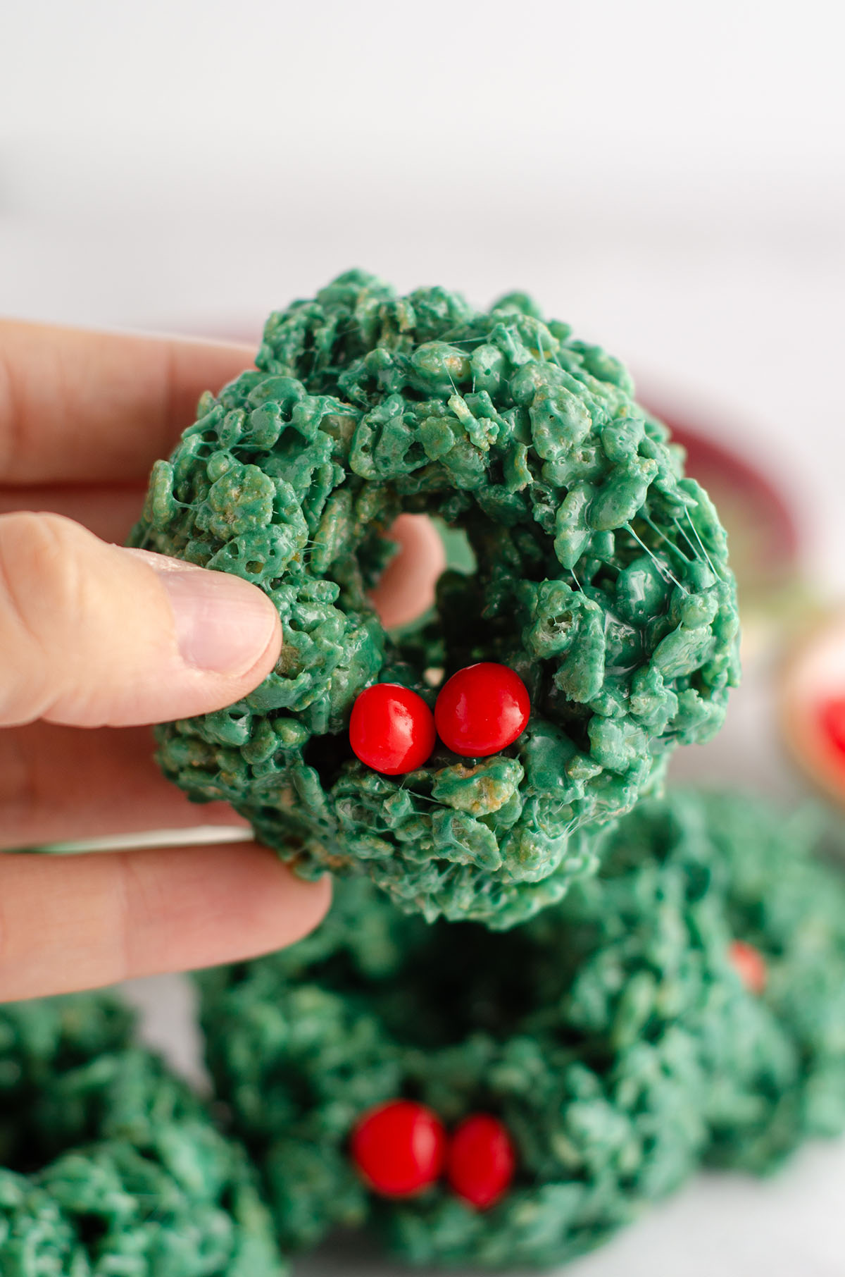 hand holding a rice krispies wreath