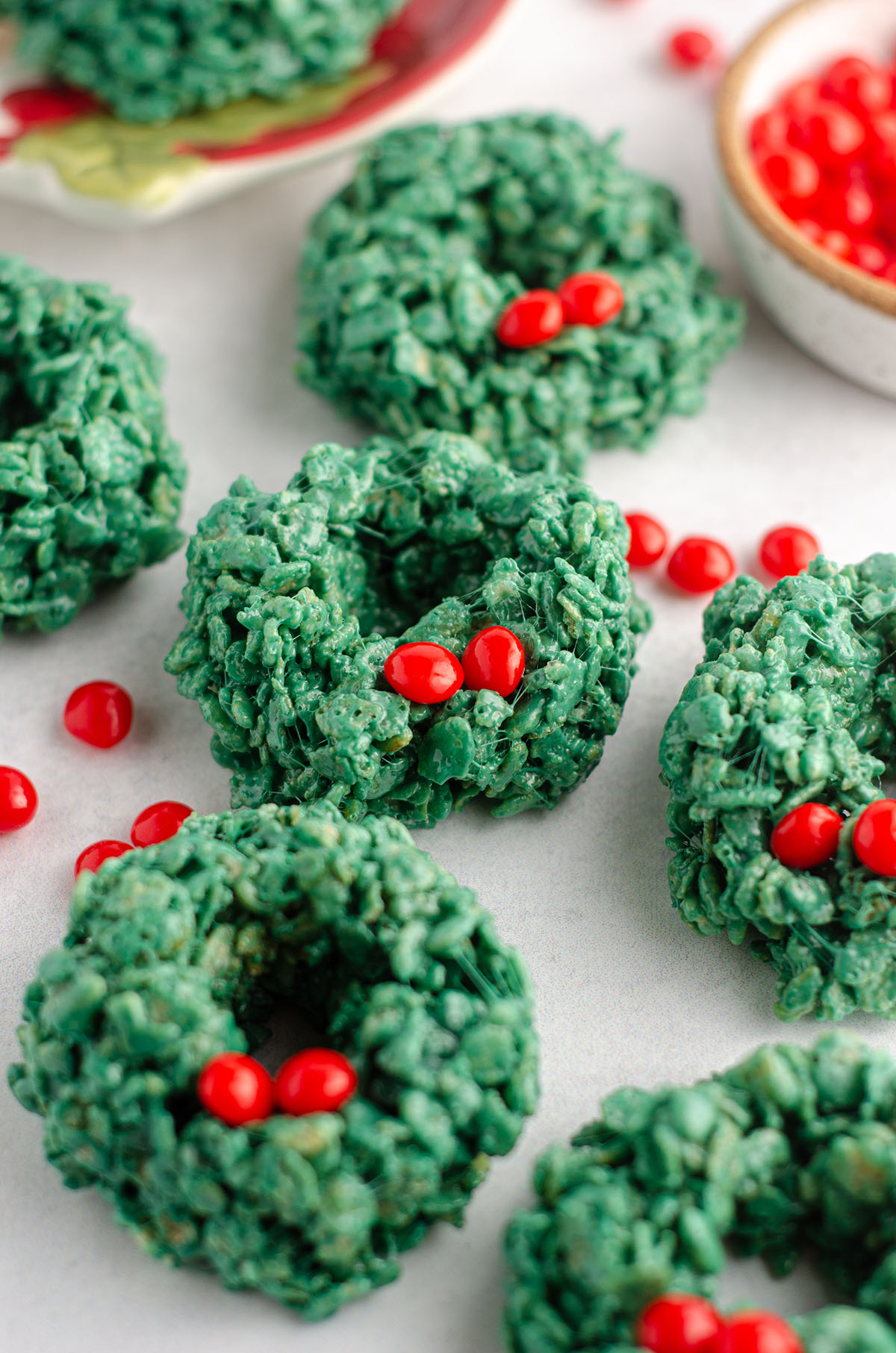rice krispies wreaths with red candies scattered around