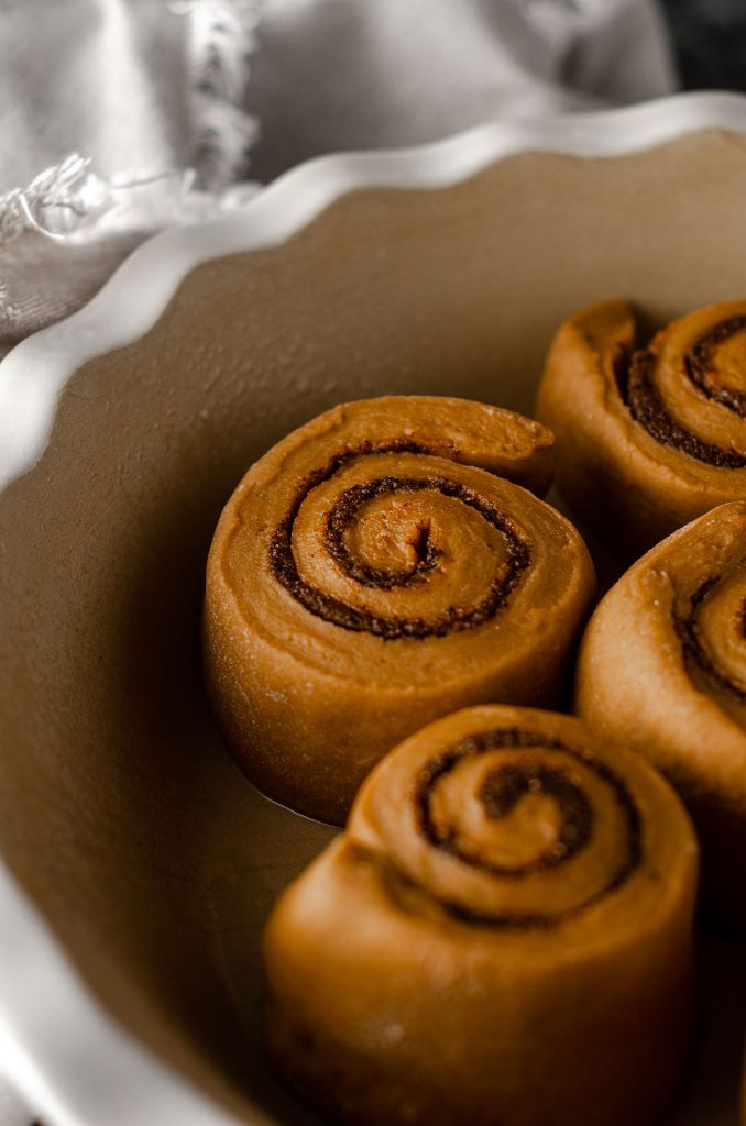 coffee cinnamon roll dough in a pie dish ready to rise