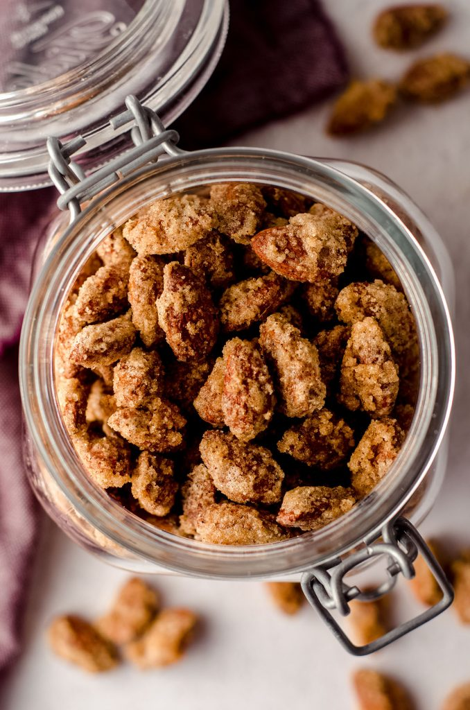 aerial photo of a jar of candied almonds with the lid open