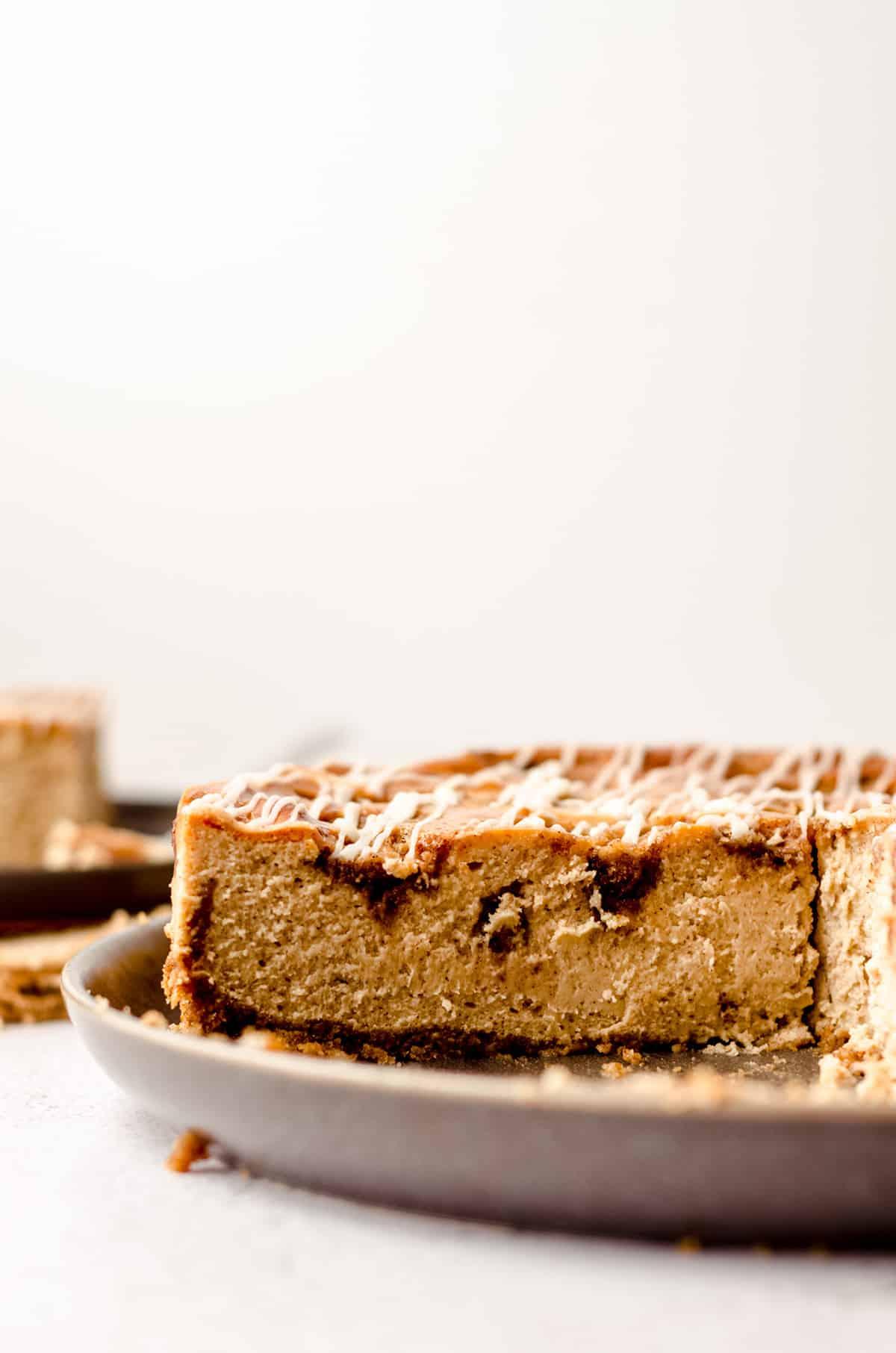 sliced cinnamon roll cheesecake on a plate