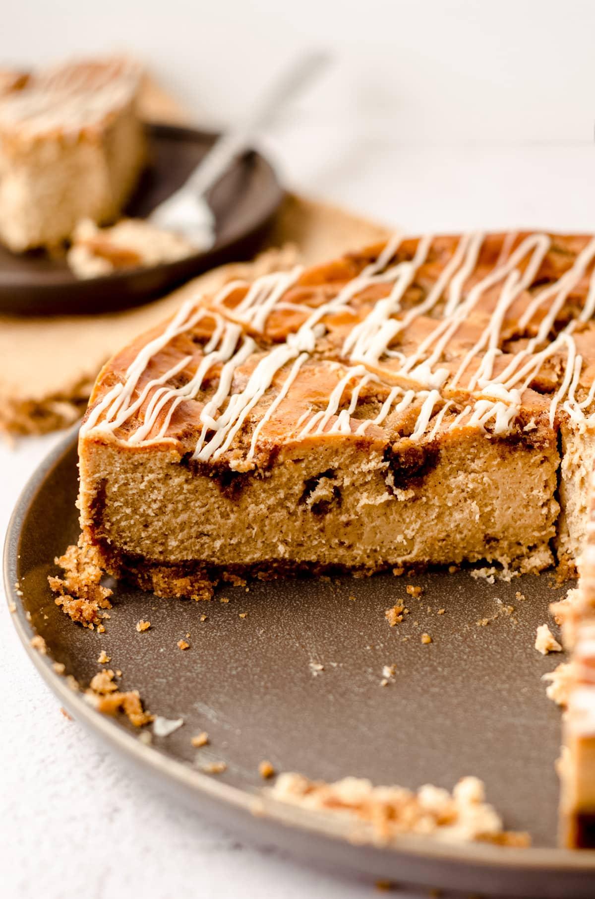 sliced cinnamon roll cheesecake in a springform pan
