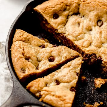nutella skillet cookie in a cast iron skillet cut into slices
