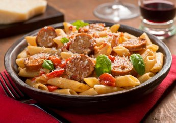 Cajun style pasta with penne, spicy sausage, red peppers, and tomato sauce with freshly grated parmesan cheese.