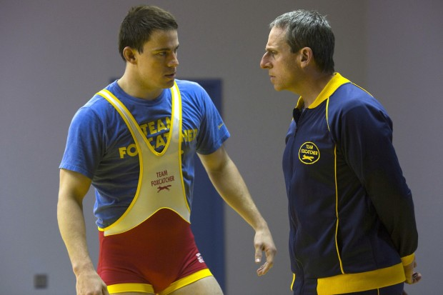 Steve Carell's John du Pont (right) coaching Channing Tatum's Mark Schultz in FOXCATCHER.