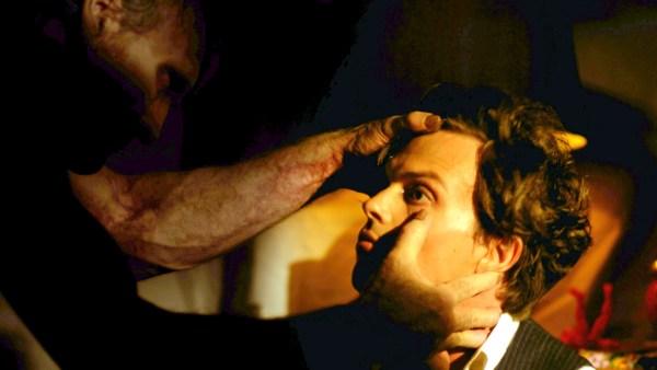 Ambrose (Muse Watson) grabs Raymond (Gubler). Photo courtesy of FilmBuff.