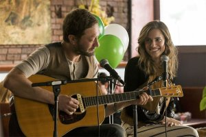 Desi (Ebon Moss-Bachrach) and Marnie (Allison Williams) play a gig. Photo courtesy of HBO.