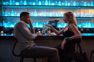 Will Smith and Margot Robbie star in FOCUS. Photo courtesy of Warner Bros.