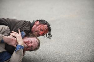 Andrew Lincoln as Rick Grimes and Corey Brill as Pete - The Walking Dead _ Season 5, Episode 15 - Photo Credit: Gene Page/AMC