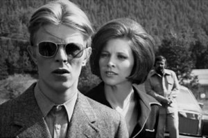 David Bowie, Candy Clark and Tony Mascia in THE MAN WHO FELL FROM EARTH. Photo courtesy of Cinema 5 Distributing.