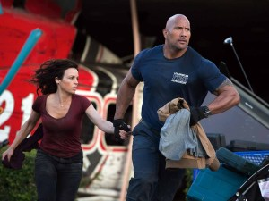"""Carla Gugino and Dwayne """"The Rock"""" Johnson fight a crumbling Earth in SAN ANDREAS. Photo courtesy of Warner Bros."""