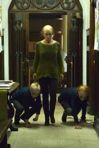 """Kelly Goodweather (Natalie Brown) and the creepy """"Feelers."""" Photo courtesy of Michael Gibson/FX."""