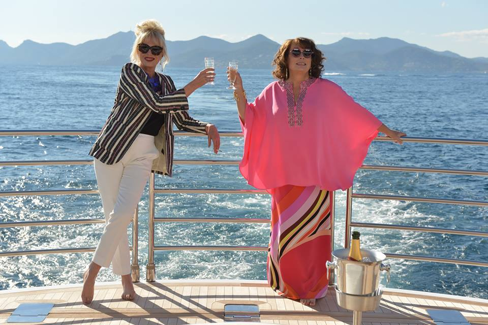 Jennifer Saunders & Joanna Lumley Lap Up Luxury, Booze & Men In 'ABSOLUTELY FABULOUS: THE MOVIE' Teaser