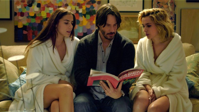 Lorenza Izzo (Genesis), Ana De Armas (Bel), Keanu Reeves (Evan) in KNOCK KNOCK. Courtesy of Lionsgate.