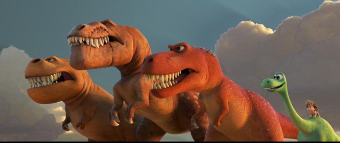 A pack of T-Rexs show Arlo how to growl in THE GOOD DINOSAUR. Courtesy of Disney-Pixar.