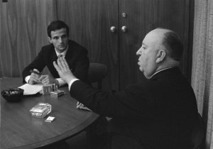 Alfred Hitchcock talks and Francois Truffaut listens in HITCHCOCK/ TRUFFAUT. Courtesy of Cohen Media Group.