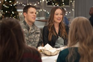 Jake Lacy and Olivia Wilde make up the only decent subplot to LOVE THE COOPERS. Photo courtesy of CBS Films.
