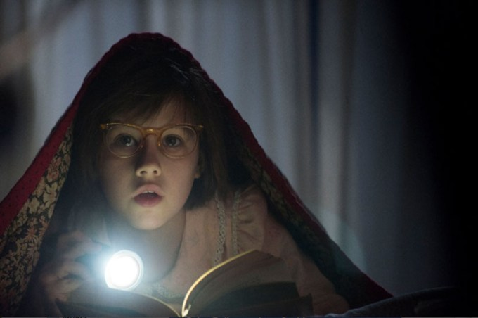 Ruby Barnhill hears a noise in THE BFG. Courtesy of Walt Disney Pictures.