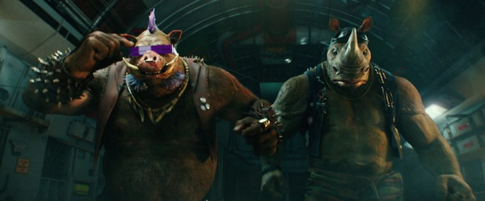 Bebop and Rocksteady are carrying out evil orders in TMNT 2. Courtesy of Paramount Pictures.
