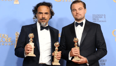 Alejandro G. Inarritu and Leonardo DiCaprio were high spirits backstage. Photo courtesy of Jim Smeal/ Rex Shutterstock.