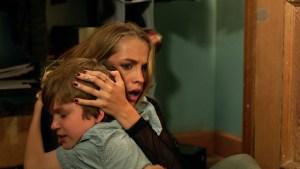 Teresa Palmer and Gabriel Bateman in Lights Out. Courtesy of Warner Brothers.