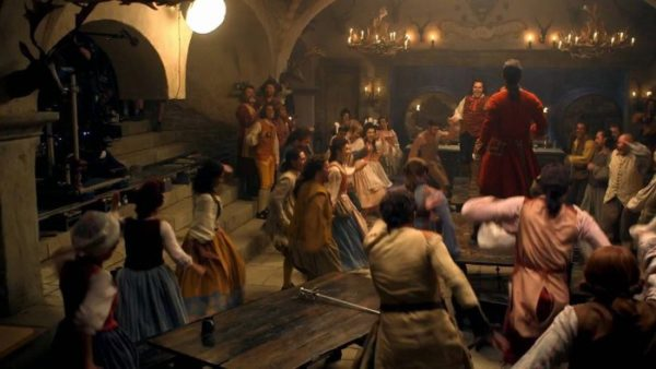 Josh Gad and Luke Evans lead a rousing chorus in BEAUTY AND THE BEAST. Courtesy of Walt Disney Pictures.