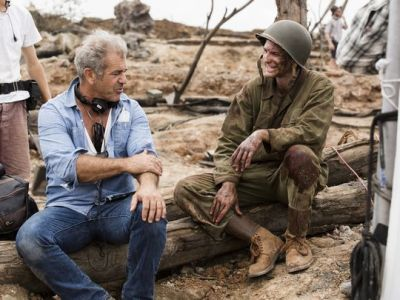 Director Mel Gibson (left) and star Andrew Garfield (right) on the set of HACKSAW RIDGE. Courtesy of Lionsgate.