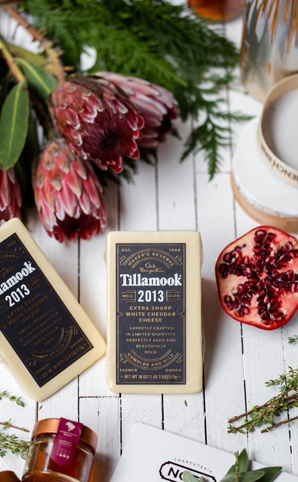 Simple to put together, thisUpscale Charcuterie Grazing Table is sure to WOW guests over the holidays. Or any time of year! what to pair with aged cheddar   appetizers   canape ideas   fancy   christmas   new years eve   champagne and cheese #Tillamook #dairydoneright#ad @tillamook